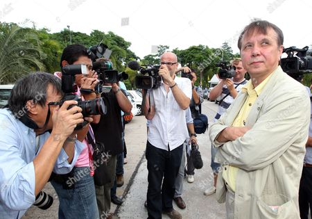 Internationally Well-known Russian Pianist and Conductor Founder and Music Director of the Russian National Orchestra Mikhail Pletnev Alleged Child Abuser is Surrounded by Media As He Appears at a Provincial Court in Pattaya Beach Resort City Chonburi Province Thailand 19 July 2010 Pletnev was Arrested by Thai Police Accused of Raping a 14-year-old Thai Boy if Found Guilty Pletnev Faces Up to 20 Years in Jail Mikhail Pletnev Denied the Pedophilia Charges of Thai Authorities Thailand Pattaya