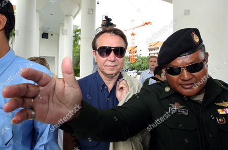 Stock Image of Internationally Well-known Russian Pianist and Conductor Mikhail Pletnev (c) Charged with Raping a Boy Arrives at the Provincial Court in Pattaya Beach Resort City Chonburi Province Thailand 30 July 2010 Pletnev was Arrested by Thai Police Accused of Raping a 14-year-old Thai Boy if Found Guilty Pletnev Faces Up to 20 Years in Jail Mikhail Pletnev Denied the Pedophilia Charges by the Thai Authorities Thailand Pattaya