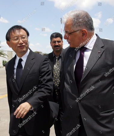 Tunisian Foreign Affairs Minister Kamel Morjane (r) Walks with His Chinese Counterpart Yang Jiechi (l) in Tunis Carthage Airport on May 17 2010 Jiechi is on a Two-day Official Visit to Tunisia on the Invitation of Morjane Tunisia Tunis