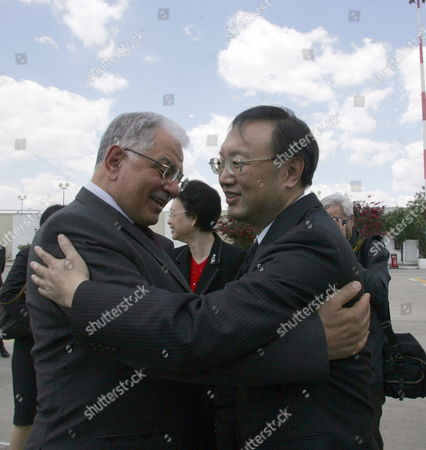 Tunisian Foreign Affairs Minister Kamel Morjane (l) Greets His Chinese Counterpart Yang Jiechi Upon His Arrival in Tunis Carthage Airport on May 17 2010 Jiechi is on a Two-day Official Visit to Tunisia on the Invitation of Morjane Tunisia Tunis