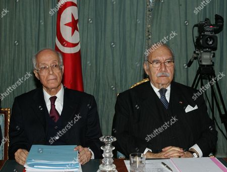 Tunisian Interim President Fouad Mebazaa (r) and Tunisian Foreign Minister Ahmed Ouneies (l) Attend a Cabinet Meeting on 01 February 2011 at the Government Palace in Tunis Tunisia It was the First Meeting of Prime Minister Mohammed Ghannouchi's Government Since It was Reshuffled on 27 January at Least 219 People Died During and in the Immediate Aftermath of Tunisia's Month-long Uprising Which Culminated in the Ouster of Autocratic Leader Zine El-abidine Ben Ali the United Nations Said Tunisia Tunis