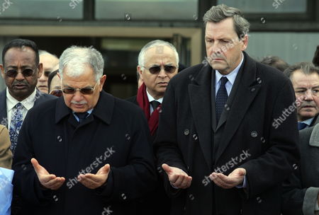 Head of the Un Peacekeeping Operation at the United Nations Alain Le Roy (r) and Tunisian Foreign Minister Kamel Morjane (l) Attend the Funeral Ceremony After the Coffin of Special Representative of the United Nations Secretary-general For Haiti (minustah) Tunisian Hedi Annabi Arrived to Tunis-carthage Airport Tunisia on 21 January 2010 Annabi Died when the Un Headquarters Building in Port-au-prince Haiti Collapsed in the Magnitude Seven Earthquake That Hit Haiti on 12 January 2010 Tunisia Tunis Carthage