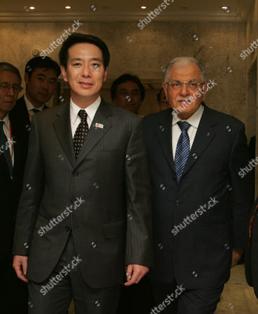 Tunisian Foreign Minister Kamel Morjane (r) Walks with His Conterpart Japanese's Seiji Maehara (l) Beford Their Meeting in Tunis on December 11 2010 Seiji Maehara is on a Two-day Afficial Visit to Tunisia Tunisia Tunis