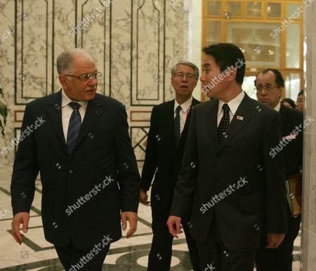Tunisian Foreign Minister Kamel Morjane (l) Walks with His Conterpart Japanese's Seiji Maehara (r) Beford Their Meeting in Tunis on December 11 2010 Seiji Maehara is on a Two-day Afficial Visit to Tunisia Tunisia Tunis