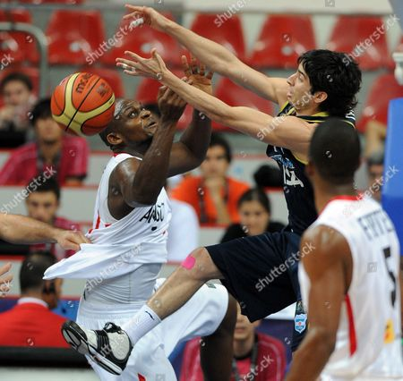 Argentina Player Luis Cequeira (r) Fights For the Ball with Angola Player Carlos Almeida (l) During the Fiba World Basketball Championship Preliminary Round Match in Kayseri Turkey on 30 August 2010 Australia Angola Germany Jordan Serbia and Argentina Play in Group a in Kayseri Turkey Kayseri