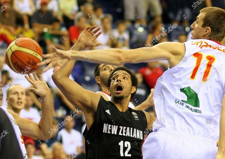 Spain's Fran Vasquez (r) Vies For the Ball with New Zealand's Benny Charles Anthony (l) During Their Fiba World Basketball Championship Preliminary Round Match at Halkapinar Arena in Izmir Turkey 29 August 2010 Turkey Izmir