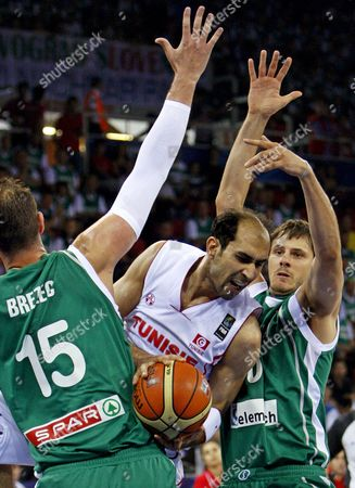 Tunisia's Radhouane Slimane (c) is Challenged by Slovenia's Primoz Brezec (l) and Bostjan Nachbar (r) During Their Fiba World Basketball Championship Preliminary Round Match at Abdi Ipekci Arena in Istanbul Turkey 28 August 2010 Turkey Istanbul