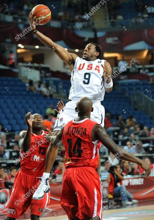 Usa Player Andre Iguodala (c) Jumps to Score Between Angolan Players Miguel Lutonda (r) and Carlos Almeida (l) During the Fiba World Basketball Championship Round of 16 Match Between Usa and Angola in Istanbul Turkey on 06 September 2010 Turkey Istanbul