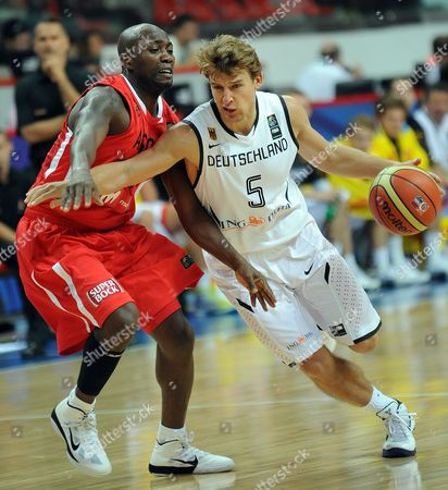 Germany's Heiko Schaffartzik (r) Drives Past Angola's Carlos Almeida (l) During Fiba World Championship in Basketball Preliminary Round Match in Kayseri Turkey 01 September 2010 Australia Angola Germany Jordan Serbia and Argentina Play in Group a in Kayseri Turkey Kayseri