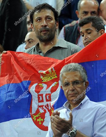 Serbian Star Vlade Divac (l) Hold Serbian Flag to Support His National Team Against Turkey During the Fiba World Basketball Championship Semi Finals Match Between Serbia and Turkey in Istanbul Turkey 11 September 2010 Turkey Istanbul