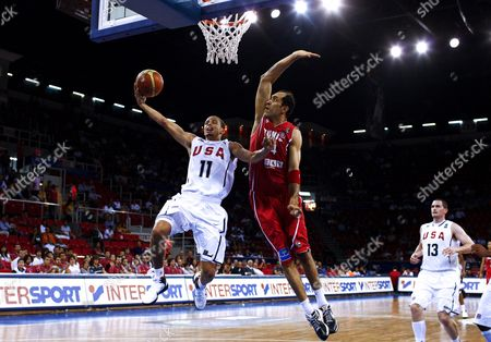 Usa's Stephen Curry (l) Goes to Basket As Tunisia's Radhouane Slimane (r) Tries to Block Him During Fiba World Basketball Championship Preliminary Round Match at Abdi Ipekci Arena in Istanbul Turkey on 02 September 2010 Turkey Istanbul