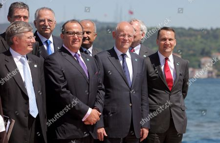 (front Row L-r) Maltese Foreign Minister Tonio Borg Moroccan Foreign Minister Taib Fassi-fihri Dutch Foreign Minister Uri Rosenthal and Polish Foreign Minister Radoslaw Sikorski Attend a Family Photo Session at the Fourth Meeting of the International Contact Group For Libya in Istanbul Turkey on 15 July 2011 Foreign Ministers and Representatives of International Organizations Arrived in Turkey For the Fourth Meeting of the Libya Contact Group Since the Armed Conflict Began the Diplomats Are to Discuss Ways to End to the Five-month Conflict Between Forces Loyal to Leader Muammar Gaddafi and the Rebels Seeking His Ouster the Benghazi-based Opposition Transitional National Council Has Stressed That a Political Solution Would not Include Gaddafi and His Government Turkey Istanbul