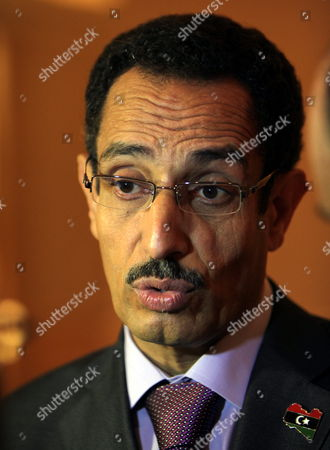 Abdul Hafiz Ghoga Vice Chairman of the Libyan Rebels National Provisional Council Speaks to Media Before the Third Meeting of the International Contact Group For Libya Which is Held at the Emirates Palace Hotel in Abu Dhabi United Arab Emirates on 09 June 2011 More Than 20 Foreign Ministers and Representatives of Regional and International Organizations Attend the Meeting Including the Gulf Cooperation Council the Arab League the Organization of the Islamic Conference the United Nations the African Union the European Union and Nato the Contact Group's Meeting Assess the International Engagement with Libya and Review Further Action to Implement United Nations Security Council Resolutions 1970 and 1973 the Contact Group is Also Expected to Discuss the Best Modality to Support the Transitional National Council As Well As to Further Coordinate International Efforts to Support the Libyan People United Arab Emirates Abu Dhabi