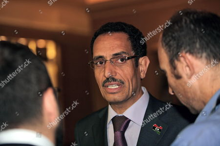 Abdul Hafiz Ghoga (c) Vice Chairman of the Libyan Rebels National Provisional Council Speaks to Media Before the Third Meeting of the International Contact Group For Libya Which is Held at the Emirates Palace Hotel in Abu Dhabi United Arab Emirates on 09 June 2011 More Than 20 Foreign Ministers and Representatives of Regional and International Organizations Attend the Meeting Including the Gulf Cooperation Council the Arab League the Organization of the Islamic Conference the United Nations the African Union the European Union and Nato the Contact Group's Meeting Assess the International Engagement with Libya and Review Further Action to Implement United Nations Security Council Resolutions 1970 and 1973 the Contact Group is Also Expected to Discuss the Best Modality to Support the Transitional National Council As Well As to Further Coordinate International Efforts to Support the Libyan People United Arab Emirates Abu Dhabi