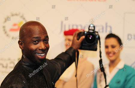 Us Ugandan Actor Ntare Mwine Poses As He Holds a Camera at the Opening Ceremony of the Dubai International Film Festival (diff) at Madient Jumierah in Dubai Uae 12 December 2010 Diff Runs From 12 Until 19 December 2010 United Arab Emirates Dubai