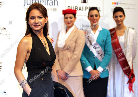 Egyptian Actress Nelly Karim (l) Poses on Arrival at the Dubai International Film Festival (diff) at Madient Jumierah in Dubai Uae 13 December 2010 Diff Runs From 12 Until 19 December 2010 United Arab Emirates Dubai