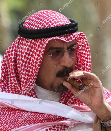 Kuwait's Foreign Minister Sheikh Mohammad Sabah Al-salem Al-sabah Smokes a Cigar on the Sidelines of the Global Anti-piracy Conference in the Gulf Emirate of Dubai United Arab Emirates 18 April 2011 the Two-day Conference to Tackle Maritime Piracy Has Opened in Dubai As Attacks Hit Record Numbers Despite International Naval Efforts to Stem the Activity the Conference is Attended by Shipping Industry Leaders Foreign Ministers and Independent Experts United Arab Emirates Dubai