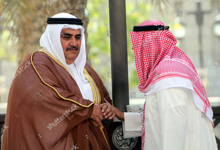 Bahrain's Foreign Minister Sheikh Khalid Bin Ahmed Al-khalifa(l) Talks with Kuwait's Foreign Minister Sheikh Mohammad Sabah Al-salem Al-sabah(r) on the Sidelines of the Conference of Global Conference For Counter-piracy in Gulf Emirate of Dubai United Arab Emirates 18 April 2011 Global Challenge Regional Responses: Forging a Common Approach to Maritime Piracy Which is a Public-private Counter-piracy Conference Organised by the Uae Ministry of Foreign Affairs in Association with Dp World (epa Photo/ali Haider) United Arab Emirates Dubai