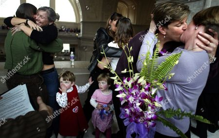 Stock Image of (l to R) Just Married Spouses Derryn Grey and Kim Wilson Pam Molsick and Helen Gibson with Their Twin Daughters Haley (bottom L) 4 and Camille (bottom R) and Lois Bukowski and Kathryn Baer All From Oakland California Celebrate with Other Same-sex Couples For Valentine's Day at City Hall in San Francisco California Saturday 14 February 2004 On 12 February 2004 the City of San Francisco Became the First Government in the United States to Grant Marriage Licenses to Same-sex Couples Set in Motion by a Directive From Mayor Gavin Newsom
