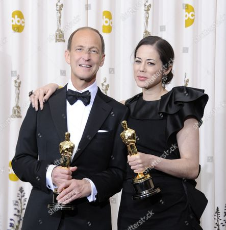 Stock Photo of Us Directors/producers Charles Ferguson and Audrey Marrs with Their Oscars For Best Documentary Feature For Inside Job the 83rd Annual Academy Awards at the Kodak Theatre in Hollywood California Usa 27 February 2011 the Oscars Are Presented For Outstanding Individual Or Collective Efforts in Up to 25 Categories in Filmmaking United States Hollywood