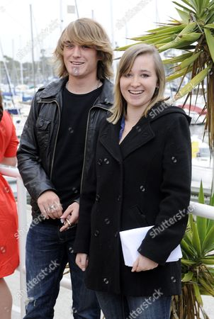 Sixteen-year-old Us Sailor Abby Sunderland (r) with Her Brother Zac (l) 18 by Her Side Pose For Photos Following a Press Conference About Her Sailing Accident That Cut Short Her Attempt to Set a Record As the Youngest Sailor to Sail Solo Around the World in Marina Del Rey California 29 June 2010 Sunderland Set Sail on 23 January 2010 and Her Boat Capsized and Her Mast was Broken by a Rogue Wave on 10 June 2010 in the Indian Ocean She was Rescued Two Days Later by a French Fishing Vessel United States Marina Del Rey