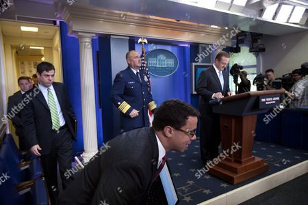 White House Deputy Press Secretary Bill Burton (bottom Center) Ducks out of the Way As Us National Incident Commander Admiral Thad Allen (c) Joins White House Press Secretary Robert Gibbs (r) For a Press Briefing in the White House Briefing Room to Update Reporters on the Gulf Oil Crisis in Washington Dc Usa on 07 June 2010 United States Washington