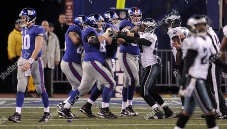 The Giants' William Beatty (2nd L) and Will Witherspoon (3rd R) Get Into a Pushing Match at the End of the Game Between the Philadelphia Eagles and the New York Giants at Giants Stadium in East Rutherford New Jersey On 13 December 2009 the Eagles Won 45-38