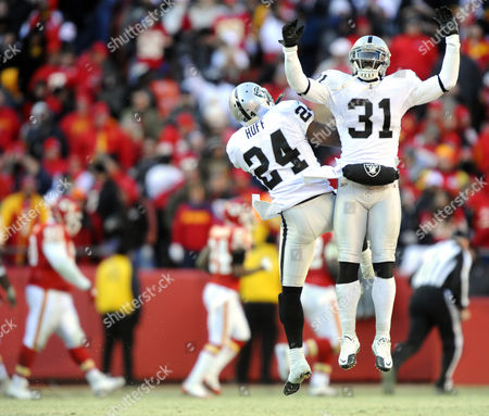Oakland Raiders Player Hiram Eugene (r) Celebrates with Teammate Michael Huff (l) After Huff Intercepted a Pass For a Touchdown Against the Kansas City Chiefs in the Second Half of the Game at Arrowhead Stadium in Kansas City Missouri Usa 02 January 2011 United States Kansas City