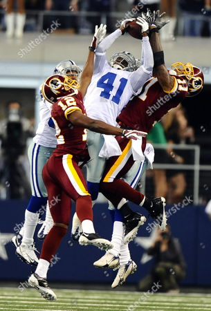 Dallas Cowboys Player Terence Newman (c) Breaks Up a Pass Against Washington Redskins Players Devin Thomas (r) and Malcolm Kelly (l) On a Hale Marry Pass in the Final Seconds of the Game in the Second Half of the Game at Cowboys Stadium in Arlington Texas Usa 22 November 2009