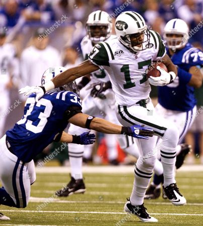 New York Jets Wide Receiver Braylon Edwards (r) Escapes the Graqsp of Indianapolis Colts Cornerback Melvin Bullitt (l) on a Pass Play in the First Quarter of Their American Football Conference Championship Game at Lucas Oil Stadium in Indianapolis Indiana Usa 24 January 2010 United States Indianapolis