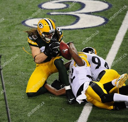 Green Bay Packers Wide Receiver Brett Swain (l) Has the Ball Stripped by Pittsburgh Steelers Cornerback William Gay (c) and Steelers Linebacker Lawrence Timmons at Cowboy Stadium For Super Bowl Xlv in Arlington Texas Usa 06 February 2011 the Steelers Are Going For Their Seventh Super Bowl Title While the Packers Are Going For Their Fourth United States Arlington