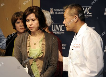 Dr Peter Rhee (r) Consoles Jenny Douglas (c) and Her Sister Crissi Blake (l) Daughters of Shooting Victim Ronald Barber Prior to Answering Questions From the Media at the University Medical Center in Tucson Arizona Usa 12 January 2011 where He is Being Treated Alleged Gunman Jared Loughner Killed 6 People and Wounded 15 Others in a Shooting Rampage in a Shopping Center where Congresswoman Gabrielle Giffords was Meeting with Constituents United States Tucson