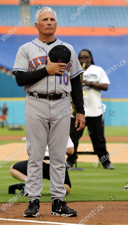 New York Mets Manager Terry Collins Stands For the National Anthem Played by Clarence Clemons (behind) Prior to the Opening Night Game Against the Florida Marlins at Sun Life Stadium in Miami Florida Usa 01 April 2011 United States Miami