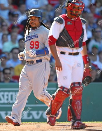 Los Angeles Dodgers Manny Ramirez (l) Scores in the Second Inning After a Single by Garret Anderson Against the Boston Red Sox at Fenway Park in Boston Massachusetts Usa 19 June 2010 United States Boston