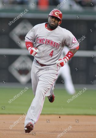 Cincinnati Reds' Brandon Phillips Rounds the Bases After Hitting a Home Run Against Philadelphia Phillies' Pitcher Roy Oswalt During the First Inning of Game 2 of Their National League Division Series Baseball Game at Citizens Bank Park in Philadelphia Pennsylvania Usa 08 October 2010 United States Philadelphia