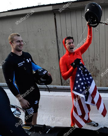 Us Comedy Central Television Host Stephen Colbert Waves the United States Flag and His Helmet After After Riding with the Fibt World Cup Bobsleigh Men's Four Man Gold Medalists Pilot Steven Holcomb (not Pictured) Curtis Tomasevicz (l) and Justin Olsen (not Pictured) in an Effort to Raise Awareness For Olympic Winter Sports at the Olympic Sports Complex Track at Mt Van Hoevenberg in Lake Placid New York Usa 22 November 2009