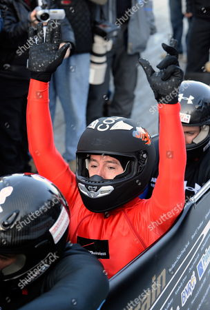 Us Comedy Central Television Host Stephen Colbert Celebrates After Riding with the Fibt World Cup Bobsleigh Men's Four Man Gold Medalists Pilot Steven Holcomb Curtis Tomasevicz and Justin Olsen in an Effort to Raise Awareness For Olympic Winter Sports at the Olympic Sports Complex Track at Mt Van Hoevenberg in Lake Placid New York Usa 22 November 2009