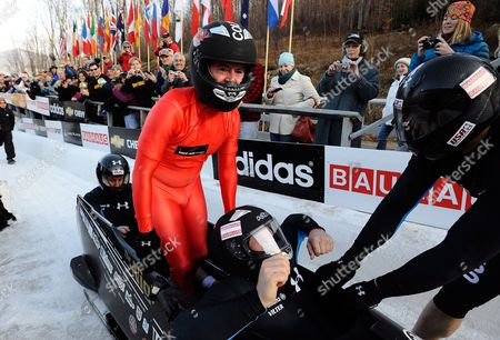 Us Comedy Central Television Host Stephen Colbert (2l) Exits the Bobsleigh After Riding with the Fibt World Cup Bobsleigh Men's Four Man Gold Medalists Curtis Tomasevicz (l) Pilot Steven Holcomb (2r) and Justin Olsen (r) in an Effort to Raise Awareness For Olympic Winter Sports at the Olympic Sports Complex Track at Mt Van Hoevenberg in Lake Placid New York Usa 22 November 2009
