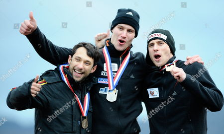 Members of the German National Team Sixth Place Finisher Michi Halilovic of Germany (l) Silver Medal Winner Sandro Stielicke of Germany (c) and Gold Medal Winner Frank Rommel of Germany (r) Gesture For Their Teammates Following the Medal Ceremony For the Men's Skeleton Competition During the Fibt World Cup Bobsleigh and Skeleton Championships Held at the Olympic Sports Complex Track at Mt Van Hoevenberg in Lake Placid New York Usa 20 November 2009 Ii United States Lake Placid