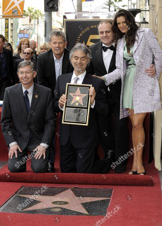 Italian Singer/composer Andrea Bocelli (c) Holds a Replica of His Star As Hollywood Chamber of Commerce Ceo Leron Gubler (l) and Fiance Veronica Berti (r) Canadian Music Producer David Foster (2-l) and Secretary General of the Capri in the World Institute Pascal Vicedomini (2-r) Look on in Hollywood California Usa 02 March 2010 Bocelli was Honored with the 2 402nd Star For His Contributions to the Entertainment Industry United States Hollywood