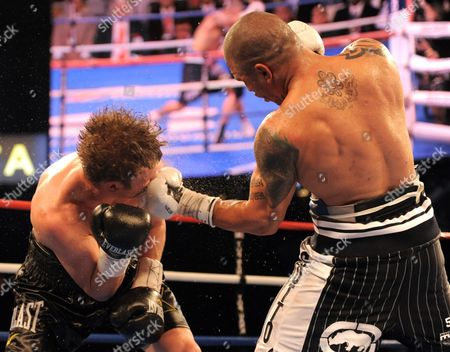 Miguel Cotto (r) of Puerto Rico Hits Yuri Foreman (l) of the United States Before Defeating Him During the Wba World Super Welterweight Title Fight at Yankees Stadium in the Bronx New York Usa on 05 June 2010 United States New York