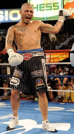 Miguel Cotto of Puerto Rico Celebrates After Defeating Yuri Foreman of the United States During the Wba World Super Welterweight Title Fight at Yankees Stadium in the Bronx New York Usa on 05 June 2010 United States Bronx