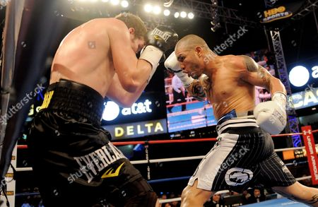 Miguel Cotto (r) of Puerto Rico Hits Yuri Foreman (l) of the United States with a Flurry of Blows Before Defeating Him During the Wba World Super Welterweight Title Fight at Yankees Stadium in the Bronx New York Usa on 05 June 2010 United States Bronx