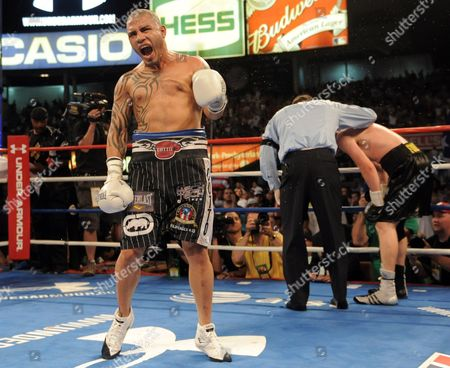 Miguel Cotto (l) of Puerto Rico Celebrates After Defeating Yuri Foreman (r) of the United States During the Wba World Super Welterweight Title Fight at Yankees Stadium in the Bronx New York Usa on 05 June 2010 United States Bronx