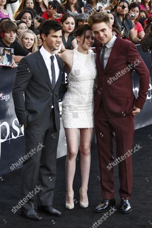 British Actor/cast Member Robert Pattinson (r-l) Us Actress/cast Member Kristen Stewart and Us Actor/cast Member Taylor Lautner Arrive at the Usa/la Premiere of 'The Twilight Saga: Eclipse' Held at the Nokia Theater at La Live in Los Angeles California Usa 24 June 2010 the Movie by British Director David Slade is the Third Installment in the Twilight Series and Will Be Released in the Us on 24 June United States Los Angeles