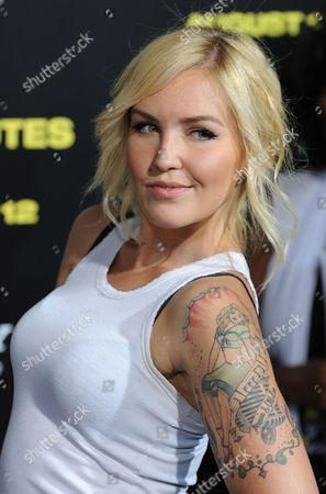 Us Country Pop Musician Cherish Lee Displays Her Tattoo As She Arrives For the 30 Minutes Or Less Movie Premiere in Hollywood California Usa 08 August 2011 United States Hollywood