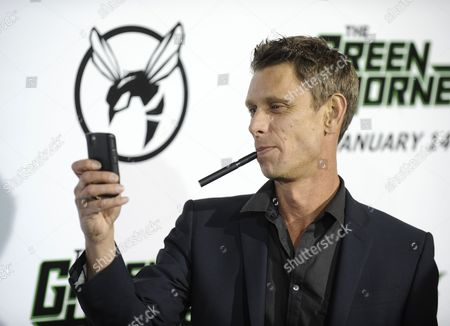 British Actor Jamie Harris Takes a Photo As He Arrives For the Green Hornet Premiere in Hollywood California Usa 10 January 2011 the Green Hornet was Originally a Serialized Radio Program in the 1930's a Popular Comic Book Character in the 1940ties and Finally a Television Series in the 1960ties United States Hollywood