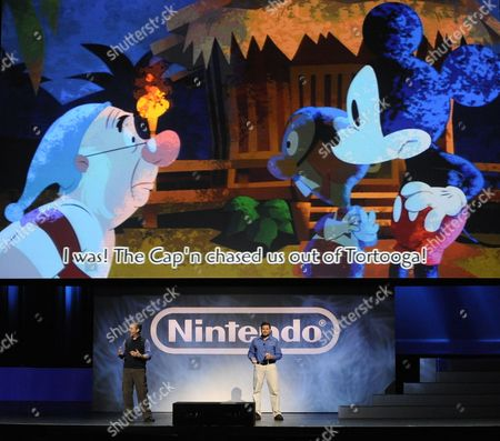 The New Nintendo Epic Mickey Video Game is Played by Adam Creighton (r) Producer Disney Epic Mickey and Warren Spector (l) General Manager and Creative Director Junction Point at the E3 (electronic Entertainment Expo) in Los Angeles California Usa 15 June 2010 the E3 Expo Introduces New Games and Gaming Devices and is an Anticipated Annual Event Among Gaming Enthusiasts and Marketers United States Los Angeles