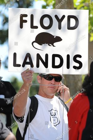 A Fan Holds a Sign Calling Us Cyclist Floyd Landis (not in Picture) a Rat Near the Finish Line During Stage Eight of the Amgen Tour of California Cycling Race in West Lake Village California Usa 23 May 2010 United States Thousand Oaks