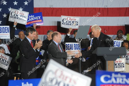 Us Vice President Joe Biden (r) Shakes Hands with Democratic Candidate For Senate Chris Coons (c) of Delaware As Democratic Candidate For the House of Representatives John Carney (l) of Delaware Looks on at a Rally For Democratic Candidates on the Eve of Midterm Elections in Wilmington Delaware Usa 01 November 2010 United States Wilmington